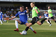 Leeds United's Luke Ayling(2) tackles Forest Green Rovers Joseph Mills (23) during the Pre-Season Friendly match between Forest Green Rovers and Leeds United at the New Lawn, Forest Green, United Kingdom on 17 July 2018. Picture by Alan Franklin.