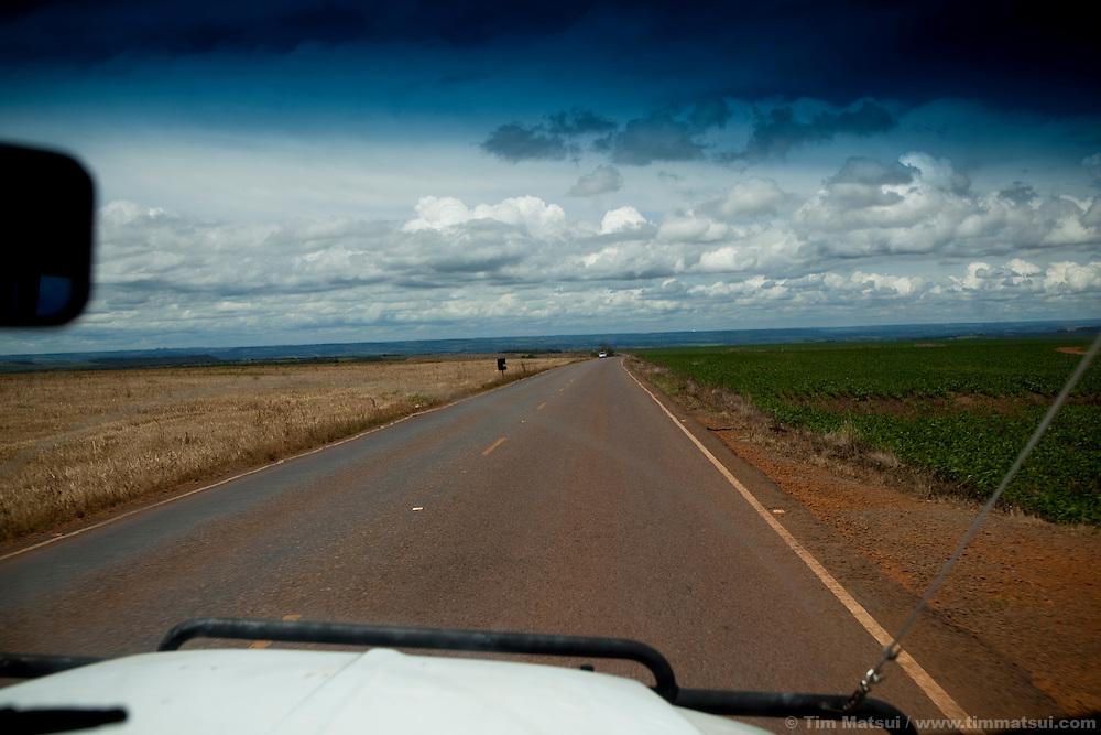 Driving to Caldas Novas near Brasilia, Brazil, passing fields of soy and corn.