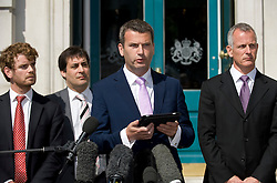 © licensed to London News Pictures. 11/07/2011. Mark Lewis (centre), Solicitor to the Dowler family leaving a press conference outside the Cabinet Office following a meeting with Deputy Prime Minister Nick Clegg today (11/07/2011) to discuss the News of The World phone hacking scandal. Photo credit should read Ben Cawthra/LNP