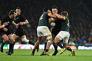 New Zealand centre Sonny Bill Williams is tackled by South Africa centre Damian De Allende during the Rugby World Cup Semi-Final match between South Africa and New Zealand at Twickenham, Richmond, United Kingdom on 24 October 2015. Photo by David Charbit.