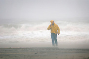 A pedestrian surveys the damage along the beach in Asbury Park during the dangerous conditions of Hurricane Sandy on October 29. Hurricane Sandy continued on its path Monday, forcing the shutdown of mass transit, schools and financial markets, sending coastal residents fleeing for higher ground, and threatening a dangerous mix of high winds and soaking rain.