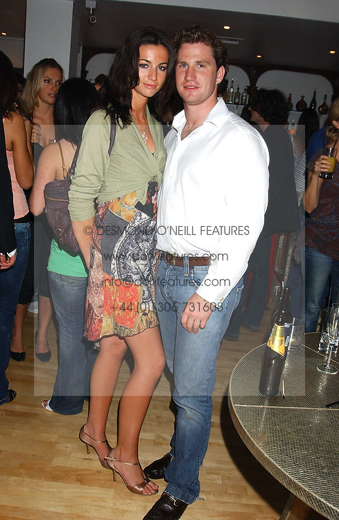 Left to right, MARIE DONOHUE and ED HAUGHEY at the launch of Friday Nights at Mamilanji - Chelsea's newest and most exclusive members club, 107 Kings Road, London SW3 hosted by Charlie Gilkes and Duncan Stirling held on 29th July 2005.<br /><br />NON EXCLUSIVE - WORLD RIGHTS