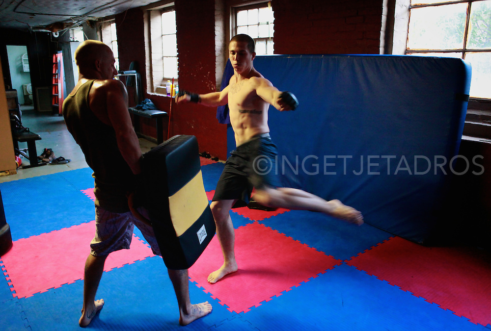 Tom trains with Jeff Atkinson, his brother-in-law, at Chiles Martial Arts Studio.  Jeff just began training, but has not yet entered the cage..