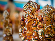 20 SEPTEMBER 2015 - SARIKA, NAKHON NAYOK, THAILAND:  Ganesha statues for sale at Shri Utthayan Ganesha Temple in Sarika, Nakhon Nayok. Ganesh Chaturthi, also known as Vinayaka Chaturthi, is a Hindu festival dedicated to Lord Ganesh. Ganesh is the patron of arts and sciences, the deity of intellect and wisdom -- identified by his elephant head. The holiday is celebrated for 10 days. Wat Utthaya Ganesh in Nakhon Nayok province, is a Buddhist temple that venerates Ganesh, who is popular with Thai Buddhists. The temple draws both Buddhists and Hindus and celebrates the Ganesh holiday a week ahead of most other places.    PHOTO BY JACK KURTZ