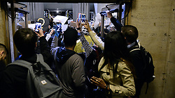 The west entrance of 30th St. Station is temporary blocked as protestors, bicycle patrol officers and commuters hold up near the doors, during an Anti-Trump protest, on Thursday. (Bastiaan Slabbers for NewsWorks)