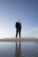 Businessman Standing in the Sand