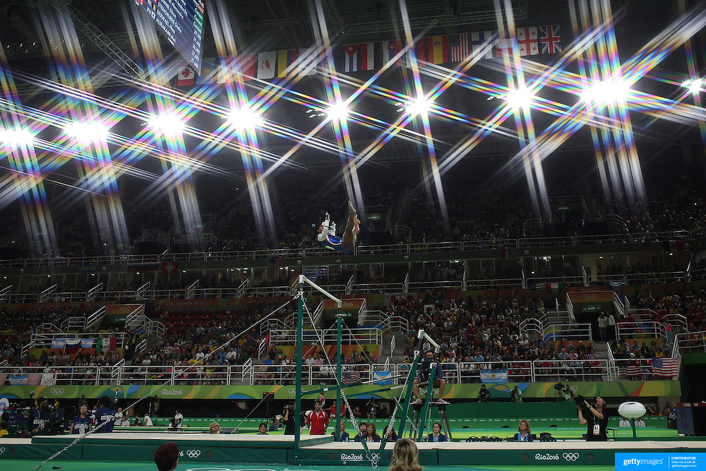 Gymnastics - Olympics: Day 6  Simone Biles of the United States performs her routine on the uneven bars during the Artistic Gymnastics Women's Individual All-Around Final at the Rio Olympic Arena on August 11, 2016 in Rio de Janeiro, Brazil. (Photo by Tim Clayton/Corbis via Getty Images)<br /> <br /> (Note to editors: A special effects starburst filter was used in the creation of this image)