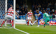 Jake Hessenthaler strikes goal wards whilst Mitchell Lund and Gary MacKenzie cover the line for  Thorsten Stuckmann during the Sky Bet League 1 match between Gillingham and Doncaster Rovers at the MEMS Priestfield Stadium, Gillingham, England on 5 September 2015. Photo by Andy Walter.