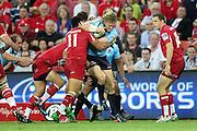 Ryan Cross is taken by Digby Ioane. Queensland Reds v NSW Waratahs. Investec Super Rugby Round 10 Match, 24 April 2011. Suncorp Stadium, Brisbane, Australia. Reds won 19-15. Photo: Clay Cross / photosport.co.nz