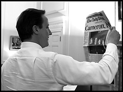 The Prime Minister David Cameron holds up the first edition of the Daily Telegraph after becoming the new Prime Minister, Tuesday May 11, 2010. Photo By Andrew Parsons / i-Images.