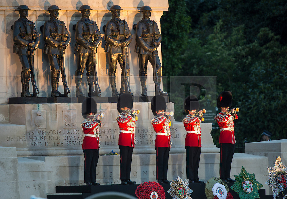 © London News Pictures. 10/06/2015. London, UK. The Household Division State Trumpeters play on the Guards Memorial on Horse Guards Parade. Waterloo 200 themed open air Beating Retreat, performed on Horseguards Parade in London. Photo credit: Sergeant Rupert Frere/LNP
