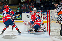 KELOWNA, CANADA - MARCH 5: Eric Williams #35 of the Spokane Chiefs defends the net against the Kelowna Rockets on March 5, 2014 at Prospera Place in Kelowna, British Columbia, Canada.   (Photo by Marissa Baecker/Getty Images)  *** Local Caption *** Eric Williams;