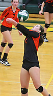 West Delaware's Carlee Ketchum (1) eyes the ball in the Class 4A regional final match at Beckman High School in Dyersville on Tuesday, November 5, 2013. West Delaware defeated Xavier 3-1.