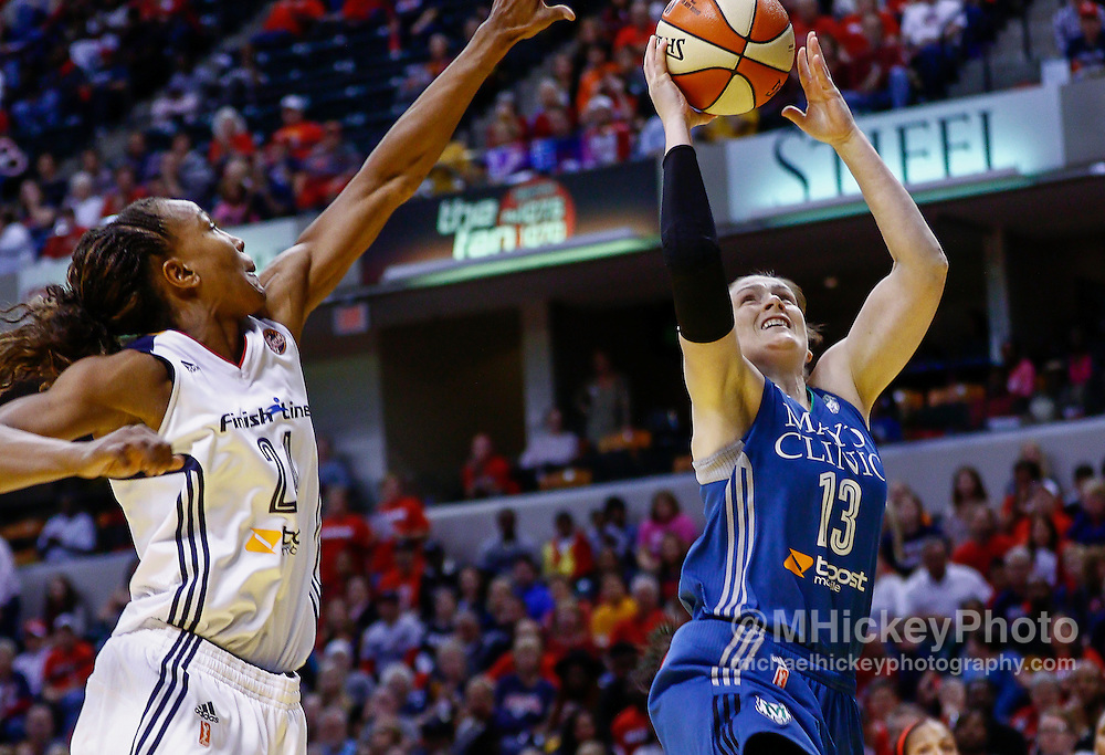 INDIANAPOLIS, IN - OCTOBER 11: Lindsay Whalen #13 of the Minnesota Lynx shoots the ball against Tamika Catchings #24 of the Indiana Fever at Bankers Life Fieldhouse on October 11, 2015 in Indianapolis, Indiana. Indiana defeated Minnesota 75-69. NOTE TO USER: User expressly acknowledges and agrees that, by downloading and or using this photograph, User is consenting to the terms and conditions of the Getty Images License Agreement. (Photo by Michael Hickey/ Getty Images) *** Local Caption *** Lindsay Whalen; Tamika Catchings