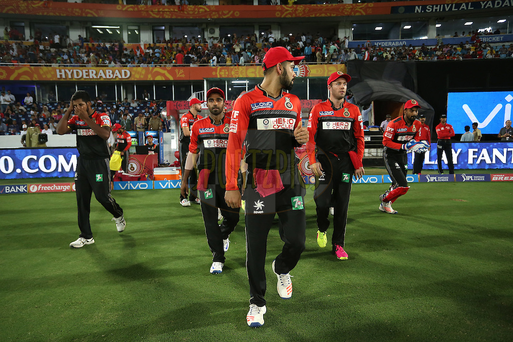 Royal Challengers Bangalore captain Virat Kohli leads his players out during match 27 of the Vivo IPL 2016 (Indian Premier League) between the Sunrisers Hyderabad and the Royal Challengers Bangalore held at the Rajiv Gandhi Intl. Cricket Stadium, Hyderabad on the 30th April 2016<br /> <br /> Photo by Shaun Roy / IPL/ SPORTZPICS