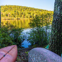 Canoes on the shore of Coldrain Pond in New Durham, New Hampshire.