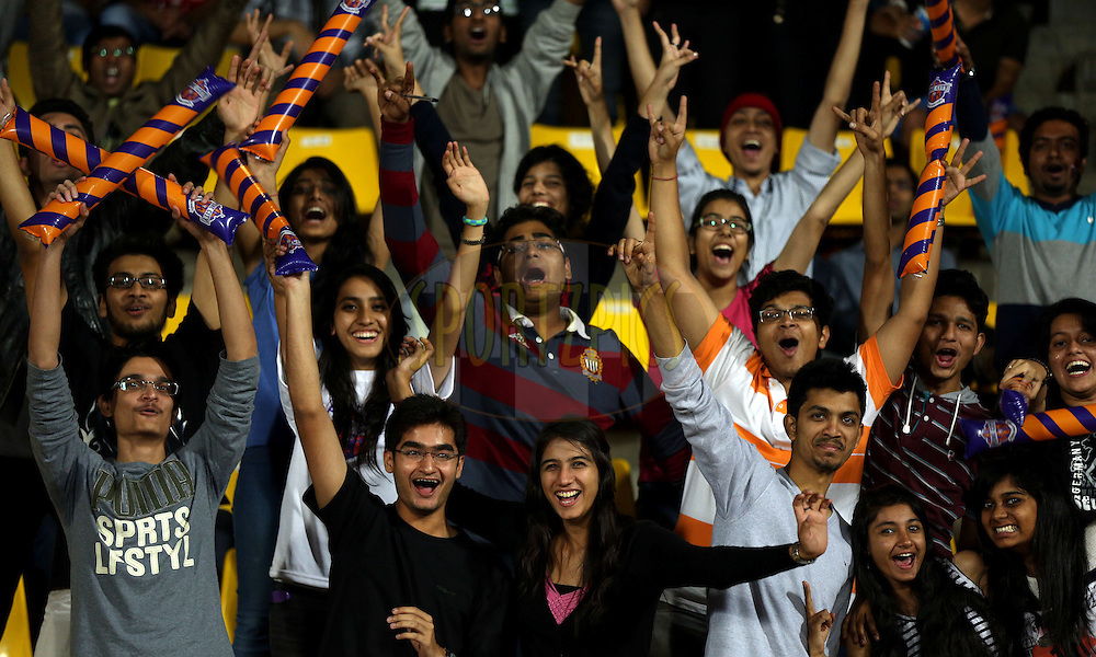 Fan's enjoy's during match 48 of the Hero Indian Super League between FC Pune City and Mumbai City FC held at the Shree Shiv Chhatrapati Sports Complex Stadium, Pune, India on the 3rd December 2014.<br /> <br /> Photo by:  Sandeep Shetty/ ISL/ SPORTZPICS