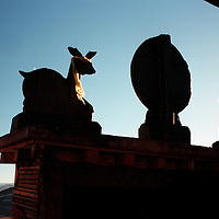 "ZHONGDIAN COUNTY, DECEMBER 19, 2000: Buddhist symbols on top of Songzanlin monastery, Yunnan province , December 19, 2000..Zhongdian county is believed to be part of the areas on which James Hilton's famous novel "" lost Horizon""- a description of Shangri-La- is modelled.. ."