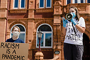 Protest organiser reads a statement to the crowd during the Black Lives Matter Protest in Merthyr Tydfil, Wales on 7 June 2020.