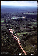 Dirt highway slicing deep into jungle allows rapid clearcutting & burning of Amazon; near Manaus Brazil