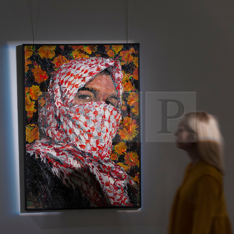 "© Licensed to London News Pictures. 13/10/2016. London, UK. A Sotheby's staff member views ""Untitled (from the Mulatham series), 2012"" by Ayman Baalbaki (est. GBP 50-70k) at the preview of Sotheby's Art of the Middle East and India exhibition, which presents artworks to be sold in New Bond Street in four sales in October. Photo credit : Stephen Chung/LNP"