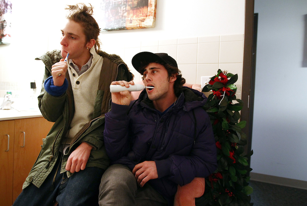 3/7/11 3:23:40 PM -- Minneapolis, MN, U.S.A.---.Jacob Allers-Hatlie, 20, left, of Lakeville, MN, and his good friend Stephen Bona, 21, of St. Paul, MN, share an apartment with two other young men in recovery at the chemical-free StepUP housing at Augsburg College in downtown Minneapolis March 7, 2011.  The pair commonly brush their teeth together while sitting in an upholstered chair in one of the apartment's two bathrooms.  Communal living is fostered by the layout of the living spaces and is an integral part of participants holding one another accountable and remaining sober. .---.Photo by Courtney Perry, Freelance.