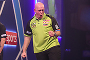 Michael van Gerwen hits a double and wins a leg and celebrates during the PDC William Hill World Darts Championship at Alexandra Palace, London, United Kingdom on 22 December 2019.