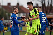 AFC Wimbledon attacker Shane McLoughlin (19) shaking hands with Bolton Wanderers defender Ryan Delaney (6) during the EFL Sky Bet League 1 match between AFC Wimbledon and Bolton Wanderers at the Cherry Red Records Stadium, Kingston, England on 7 March 2020.