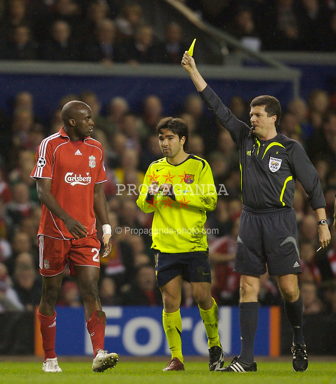 Liverpool, England - Tuesday, March 6, 2007: Mohamed Sissoko is shown the yellow card by German referee Herbert Fandel during the UEFA Champions League First Knockout Round 2nd Leg against FC Barcelona at Anfield. (Pic by David Rawcliffe/Propaganda)