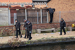© Licensed to London News Pictures . 16/11/2015 . Liverpool , UK . Search team at the Leeds-Liverpool Canal in the Eldonian Village area of Liverpool where a 16 year old boy was shot dead last night (15th November 2015 ) . Photo credit: Joel Goodman/LNP
