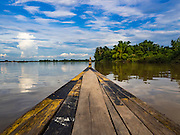 19 JUNE 2016 - DON KHONE, CHAMPASAK, LAOS: A tourist boat navigates through 4,000 Islands near Don Khone Island. Don Khone Island, one of the larger islands in the 4,000 Islands chain on the Mekong River in southern Laos. The island has become a backpacker hot spot, there are lots of guest houses and small restaurants on the north end of the island.      PHOTO BY JACK KURTZ