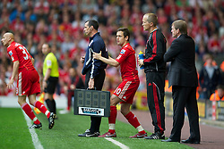 LIVERPOOL, ENGLAND - Saturday, April 23, 2011: Liverpool's Joe Cole hides behind the fourth official during the Premiership match against Birmingham City at Anfield. (Photo by David Rawcliffe/Propaganda)