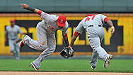 Sports Illustrated -- Los Angeles Angels shortstop Erick Aybar (24) fields a ground ball as he avoids second basemen Howie Kendrick (47) during the fourth inning against the Kansas City Royals at Kauffman Stadium.