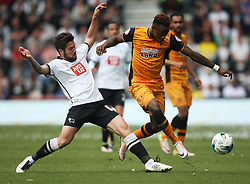 Jacob Butterfield of Derby County (L) and Moses Odubajo of Hull City in action - Mandatory by-line: Jack Phillips/JMP - 14/05/2016 - FOOTBALL - iPro Stadium - Derby, England - Derby County v Hull City - Sky Bet Championship Play-Off Semi-Final First-Leg