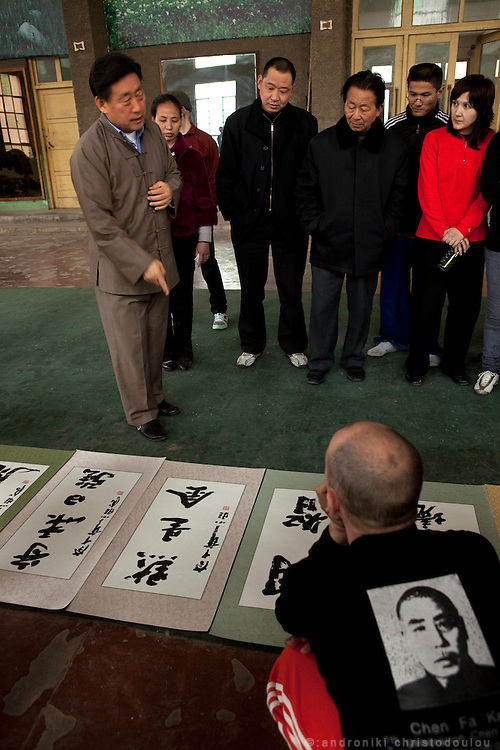 Grandmaster Chen Xiaowang presenting some of his calligraphy works to foreign and Chinese students during a seminar at the Chenjiagou Taijiquan School. Calligraphy is very important for him as he considers it almost equal to his Taijiquan skill.