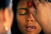 Model Malaika Firth, 19, of London, has makeup applied before the Altuzarra Fall 2014 collection is presented during Fashion Week in New York, Saturday, Feb. 8, 2014. (AP Photo/Diane Bondareff)