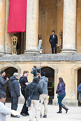 © Licensed to London News Pictures. 27/03/2015. Shah Rukh Khan (pictured top in black suit) filming for his new Bollywood production 'FAN' at Blenheim Palace in Woodstock, Oxfordshire, UK on March 27, 2015. Shah Rukh Khan (Also known as SRK) has appeared in more than 80 Bollywood films and is considered to be one of the worlds biggest film and television stars. Photo credit: Mark Hemsworth/LNP