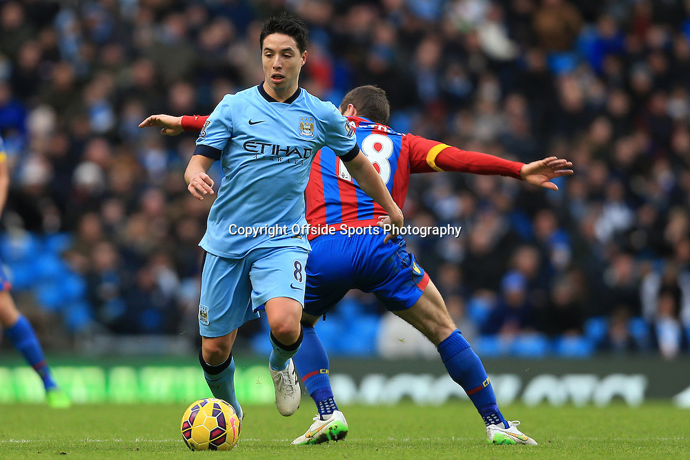 20th December 2014 - Barclays Premier League - Manchester City v Crystal Palace - Samir Nasri of Man City gets past James McArthur of Palace - Photo: Simon Stacpoole / Offside.