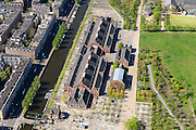 Nederland, Noord-Holland, Amsterdam, 09-04-2014;<br /> Close-up Cultuurpark Westergasfabriek en Westerpark met voormalig stadsdeel Westerpark (nu stadsdeel West) op het Westergasterrein, langs de Haarlemmertrekvaart en de Haarlemmerweg. Links van het kanaal woonwijk de multiculturele Staatsliedenbuurt.<br /> Culture park Westergasfabriek and the Westerpark on the former Westergasterrein (gasworks), and residential district on the other side of the channel.<br /> luchtfoto (toeslag op standard tarieven);<br /> aerial photo (additional fee required);<br /> copyright foto/photo Siebe Swart