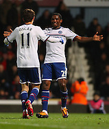 Picture by David Horn/Focus Images Ltd +44 7545 970036<br /> 23/11/2013<br /> Oscar of Chelsea celebrates scoring his team's second goal with Samuel Eto'o of Chelsea during the Barclays Premier League match at the Boleyn Ground, London.