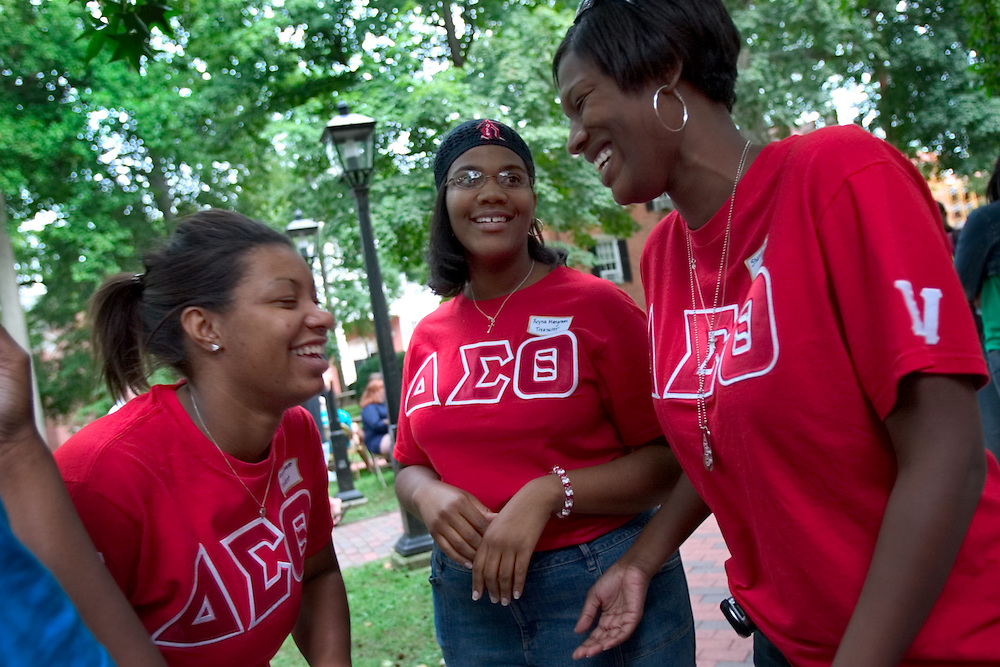 """Delta Sigma Theta Soroity sisters Arianna Edwards, Reyna Mangrum and Shanita Payne sharing a laugh during the activities fair held for the 2006 freshman class at the College Green...OPENING SCHOOL IN STYLE -- Members of the 2006 freshman class at Ohio University will get their college careers off on the right foot, both literally and figuratively, with the traditional march through the College Gate at approximately 3:15 p.m. Monday, Sept. 4. Following the President's Convocation at 2:30 p.m. in the Convocation Center, the new Bobcats will follow """"The Most Exciting Band in the Land,"""" the Marching 110, from the Convo for the trek up Richland Avenue toward the College Green as they officially begin their college careers..Once on the College Green, representatives of more than 200 student organizations across campus will have displays set up to introduce the newest Ohio University students to the many ways to become actively involved in campus life..It is a colorful tradition that captures the spirit of college life. It also makes for tremendous photo and video opportunities for a unique twist on the conventional moving-in activities as the academic years of schools, colleges and universities across the state hit full stride over Labor Day Weekend."""