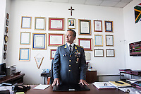 """PALERMO, ITALY - 6 JUNE 2016: Colonel Francesco Mazzotta, Commander of the Tax Police Unit of Palermo that coordinated the seizures of vessels carrying hashish from Morocco to Libya, poses for a portrait in the Guardia di Finanza (Financial Police) headquarters in Palermo, Italy, on June 6th 2016.<br /> <br /> Between January 2014 e December 2015 more than 120 tons of hashish, carried on fishing boats or cargo ships from Morocco to Libya, were seized in the Strait of Sicily by Italy's Guardia di Finanza (Financial Police) thanks to an international police investigation named """"Operazione Libeccio"""", carried out by the GICO (Gruppo Investigativo Criminalità Organizzata, Organised Crime Investigation Group), a unit of the tax police of Palermo under the supervision of the DDA (Direzione Distrettuale Antimafia) of Palermo.<br /> <br /> """"What is happening in Libya is same historical occurrence that happened years ago in Afghanistan. Such as the Talibans who financed their terroristic activities with heroin trafficking for the purchase of weapons, the Caliphate is proposing the same terroristic strategy by purchasing and commercialising hashish in order to purchase weapons used in their war"""" Sergio Barbera, Deputy General Prosecutor of Palermo, said."""