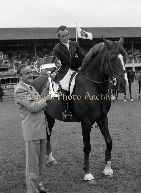 "08/08/1987<br /> 08/08/1987<br /> 08 August 1987<br /> RDS Horse Show, Ballsbridge, Dublin. The Irish Trophy - Grand Prix of Ireland. Albert Reynolds T.D.  presents the Irish Trophy to Paul Darragh on ""Carroll's Trigger""."