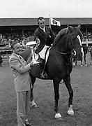 "08/08/1987<br /> 08/08/1987<br /> 08 August 1987<br /> RDS Horse Show, Ballsbridge, Dublin. The Irish Trophy - Grand Prix of Ireland. Albert Reynolds T.D.  presents the Irish Trophy to Paul Darragh on ""Carroll's Trigger""."