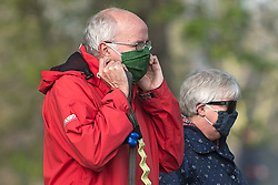 © Licensed to London News Pictures. 04/04/2020. London, UK. Two elderly members of the public wearing medical face mask while exercising in Hyde Park, London, during a pandemic outbreak of the Coronavirus COVID-19 disease. The public have been told they can only leave their homes when absolutely essential, in an attempt to fight the spread of coronavirus COVID-19 disease. Photo credit: Ben Cawthra/LNP