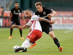 August 5, 2017 - Washington, DC, USA - 20170805 - Toronto FC midfielder VICTOR VAZQUEZ (7) passes against D.C. United midfielder JARED JEFFREY (25) in the first half at RFK Stadium in Washington. (Credit Image: © Chuck Myers via ZUMA Wire)