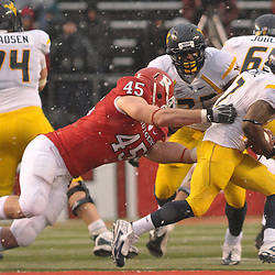 Dec 5, 2009; Piscataway, NJ, USA; Rutgers defensive end Alex Silvestro (45) drags down West Virginia running back Noel Devine (7) from behind during second half NCAA Big East college football action in West Virginia's 24-21 victory over Rutgers at Rutgers Stadium.