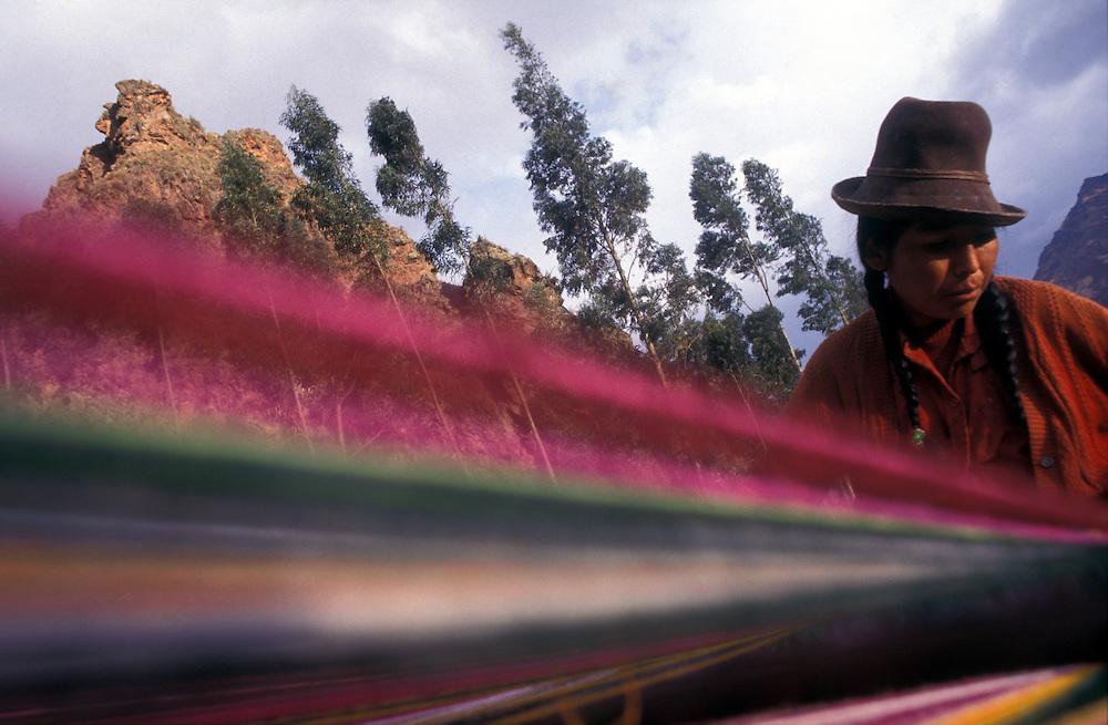 Indigenous women weaving poncho, Pisaq, Cuzco region, Peru