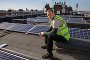 Eric from Re-Powering. <br /> Bannister House was Hackney's first community solar installation, Banister House Solar, has been developed by Repowering London in partnership with local estate residents and Hackney Council, and delivered using funds raised through a community share offer. The 102kWp solar array generates up to 82,000kWh of energy annually, saving 50,000kg of CO2 emissions. In addition, a portion of the revenue generated through the government's Feed-in Tariff and sale of energy over the 20-year life of the project will generate over £28,000 for the Banister House Solar community fund. Hackney, London.