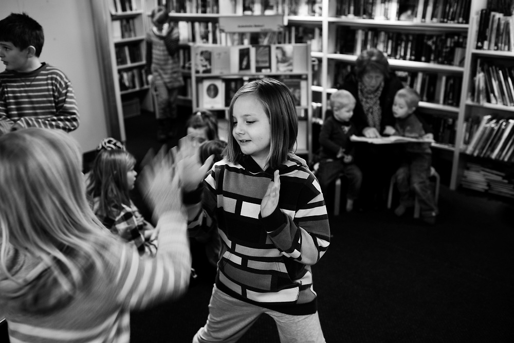 Girls playing before the entertainment starts..Photo by Knut Egil Wang /MOMENT